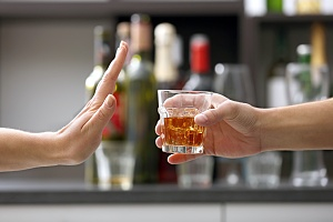 a person saying no to alcohol which helps with their alcohol dependency problems