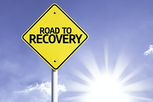 a sign that says road to recovery representing the recovery process from alcohol dependence