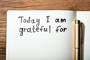 a journal with the words today i am grateful for in a recovery process