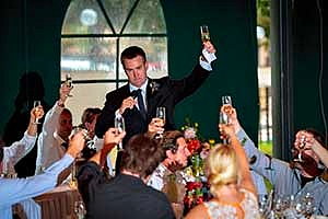 man toasting at a social event party