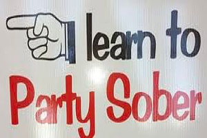 a learn to party sober sign