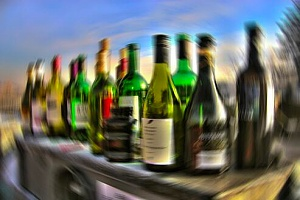 tunnel vision of a collection of alcoholic beverages bottles on a table