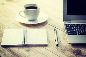 Coffee and journal on desk