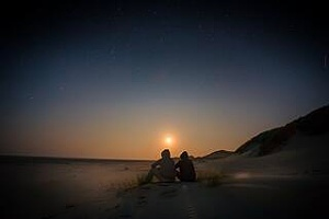 a couple overlooking a sunset after being open with each other about addiction recovery