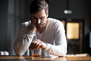 a man struggling with alcoholism drinking even though he should not