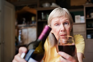 a woman over 65 who needs to reach out for help with excessive alcohol use