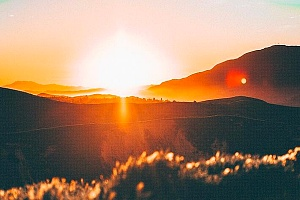 view of a sunset and hills representing positive recovery