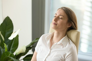 a woman reducing her stress level as a part of setting smart goals for addiction recovery