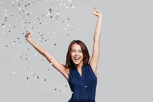 a woman celebrating her recovery milestones on her addiction recovery journey