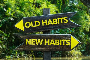 old habits and new habits on a road sign representing the recovery process