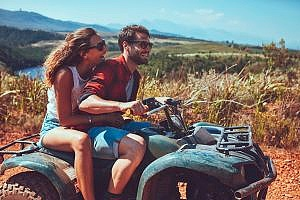 a man and woman on an ATV causing temporary relief from stress