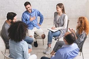 intensive outpatient program patients participating in a 12 step program meeting