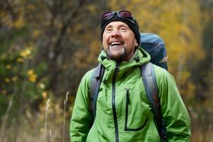 man hiking on a program