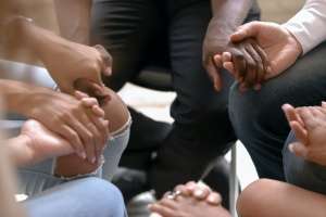 group holding hands in a Integrated Care Program