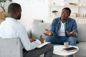 man talking to father about what is individual therapy