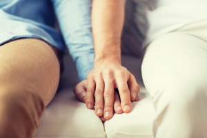 family holding hands during a session in a Family Recovery Program