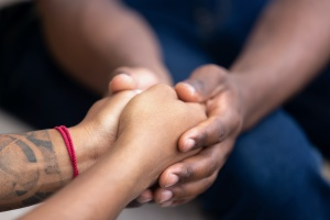 two hands holding each other in a Family Recovery Program