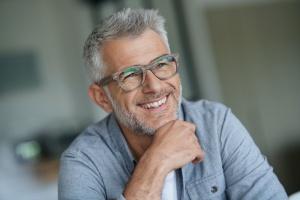 older man smiling after learning what Integrated Behavioral Model is