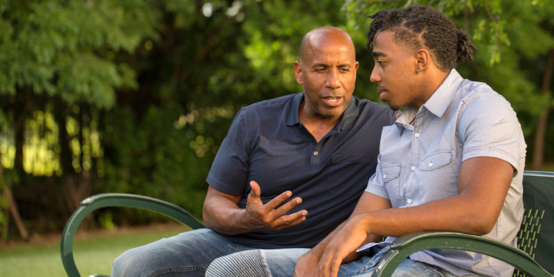 man talking to another about early signs of addiction