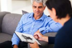 man sitting in a Individual Therapy session
