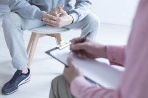 close up of a man during a individual therapy sessions