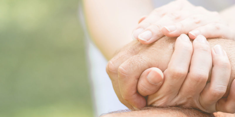 Comforting family members by holding hands of a drug overdose