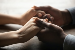 hand of loved one talking about recovery center