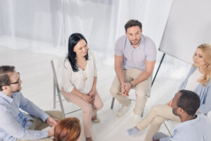 the other patients in alcohol rehab listens as one patient speaks