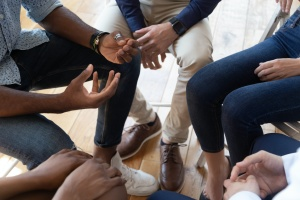 hands of people during substance abuse group therapy activities