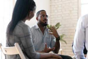 men talking in a substance abuse group therapy activities