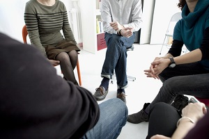 People Discussing with Eachother during substance abuse group therapy activity