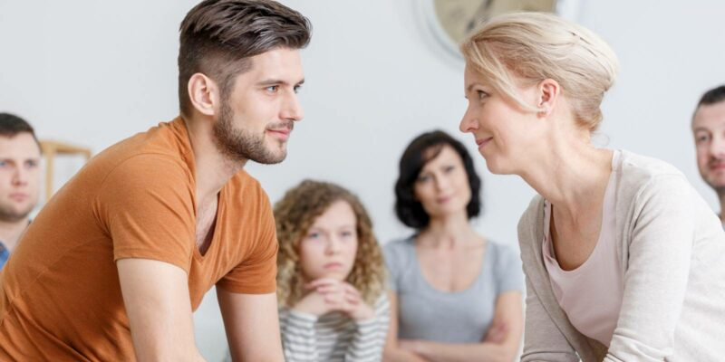 patient in drug rehab converses with therapist