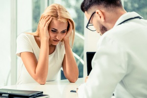 headache woman visit doctor at hospital asking about Outpatient Treatment