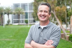 man in outpatient program smiling outside