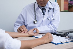 doctor taking patients pulse at Outpatient Program in hospital