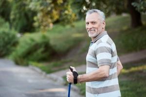 older man walking while in a  Outpatient Program