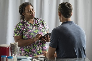 nurse receiving medical history from male patient in Outpatient Program