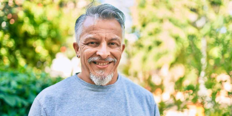 male smiling while in a outpatient program
